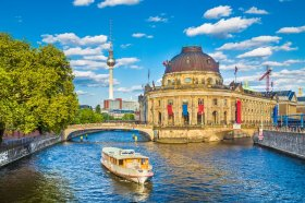 View of UNESCO World Heritage Site Museumsinsel (Museum Island) with excursion boat on Spree river, Berlin, Germany